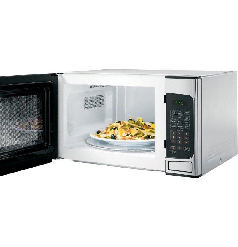 ... in Denver, CO - GE? 1.1 Cu. Ft. Capacity Countertop Microwave Oven