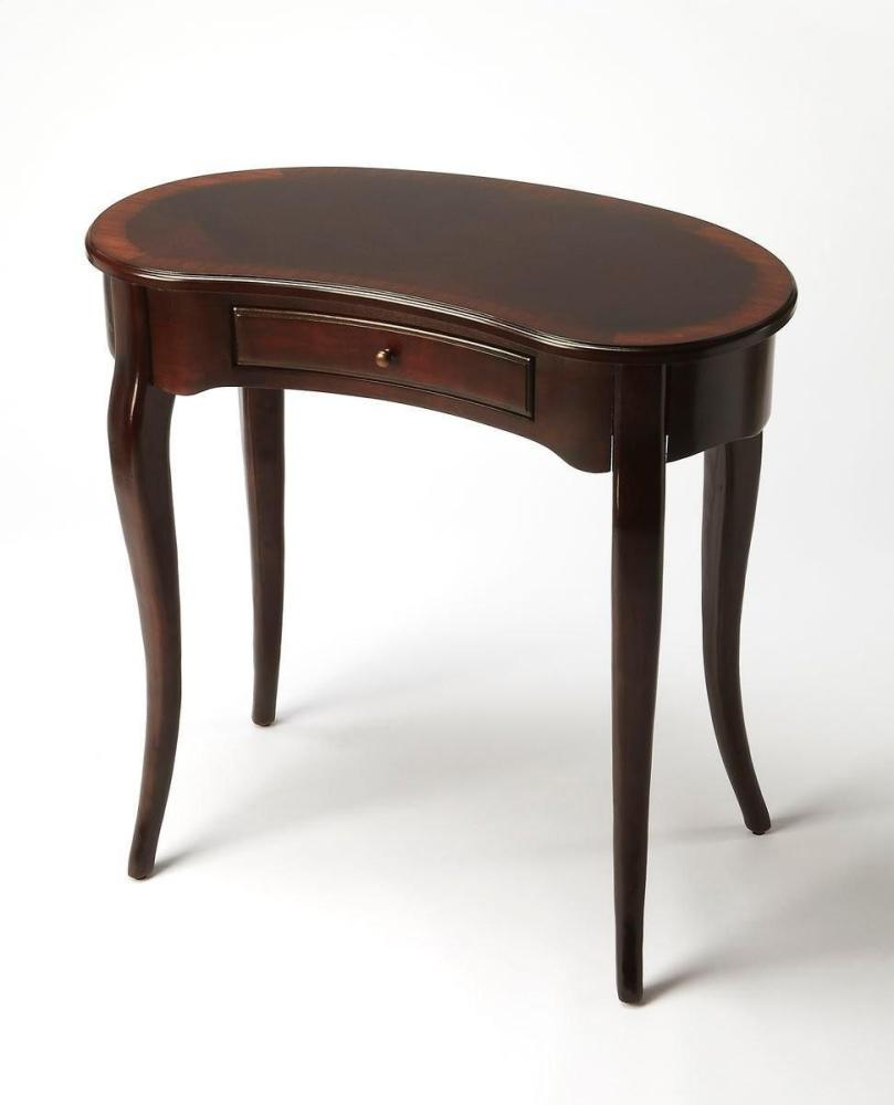 This elegant Writing Desk features a crescent shape tabletop supported by four stylized, tapered cabriole legs and a drawer with antique brass-finished hardware. It is crafted from poplar hardwood solids and wood products with a cherry veneer top inset wi