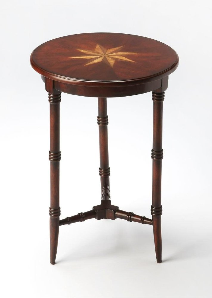 This charming accent table is sure to be a cherished addition to any space. Featuring three gracefully tapered legs with faux bamboo turnings and a matching stretcher, it is carefully crafted from select hardwood solids and wood products with a cherry ven