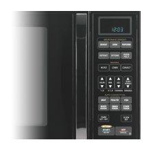 Black-on-Black 1.5 Cu. Ft. Whirlpool Gold® Sensor Microwave Oven