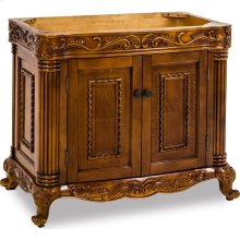 """39-11/16"""" vanity base with burled veneer and hand-carved botanical and rope details and framed with reed-style columns."""