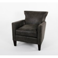 Transitional club chair with a double row of small nails on the top of the arm and the top radius of the back