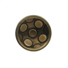 Circular-shaped knob with circular inlays made of solid brass.