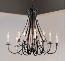 Chandelier: Sweeping Taper with nine arms on two tiers.
