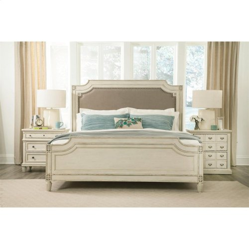 Huntleigh King Carved Upholstered Bed