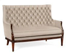 Winged loveseat upholstered in Mazo