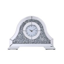 Never lose track of time again when this shining crystal enveloped square time piece shimmers in the corner of your eye. Framed within beveled mirror panels and dazzling silver crystals with trapezoid designs extending from the inner frame, youll always pay attention to the time. Sleek black hands in the classic rectangular white frame revolve […]