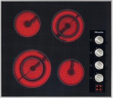 KM 5621 208V Electric cooktop with four cooking zones and direct rotary dial controls for maximum convenience.