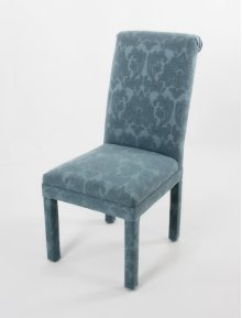 Roll back chair with covered legs