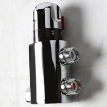 "Integrated thermostatic mixing valve. It includes built-in filters and back check valves. W: 2 1/8"", H: 5 3/8""."