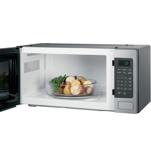 SAVE.... BRAND NEW - RETURNED FOR SMALLER UNIT - GE Profile™ Series 1.1 Cu. Ft. Countertop Microwave Oven MODEL PEM31SFSS - FULL WARRANTY