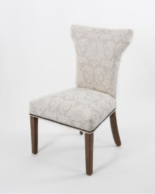Wood leg chair w/ curved back & small nails on OSB seat