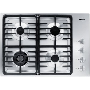 MieleGas cooktop with a dual wok burner for particularly wide ranging burner capacity.