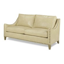 Raquel Sofa have a sexy, yet strong and versatile look. It is covered in our Rio Biscuit, Grade L2 (AP) leather which offers a soft drapeable feel with protection against spills and stains. The large (52) nailhead trim is in our Natural (01) finish and the wood is finished in our new #Reclaimed Natural wood finish. #Custom made furniture that is #made to order just for you since it is 100% #Made in the USA! Any leather, nailhead or wood finsh can be applied. You can even take the nailhead trim off altogether, for an even cleaner look.