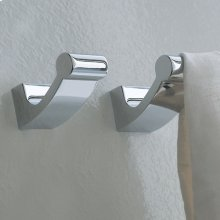 Wall-mount robe hook made of chrome plated brass.