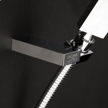 """Hook for hand-held shower head. 2 1/2""""W, 3 1/8""""D, 5/8""""H."""