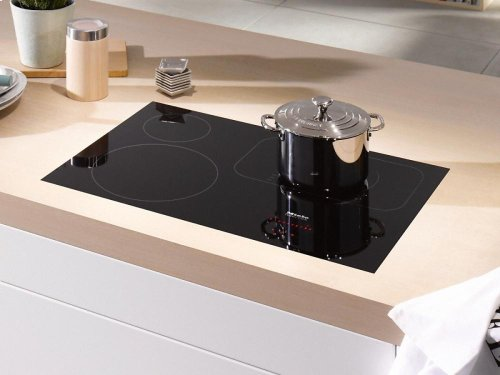 KM 6365 Induction cooktop with touch controls with PowerFlex cooking area for maximum versatility and performance.
