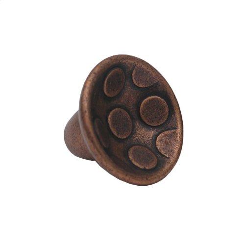 Circular-shaped knob with circular inlays made of solid brass.