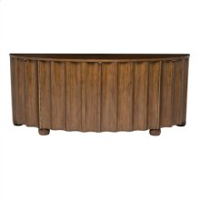 LIGHT FADED WALNUT FINISHED CH IFFONIER, SCALLOPED BOWFRONT W ITH ANTIQUE BRASS ACCENTS