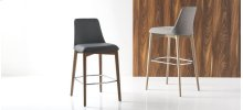 Stool with upholstered seat