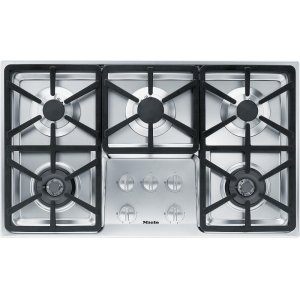 MieleKM 3474 LP Gas cooktop with 2 dual wok burners for particularly versatile cooking convenience.