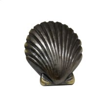 Solid brass seashell-shaped knob.