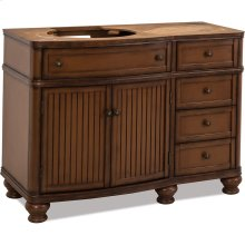 """46-1/2"""" vanity with walnut finish and simple bead board doors and curved shape."""