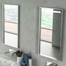 Wall-mount mirror in wooden or metal frame with LED light behind sand blasted frosted section on top.