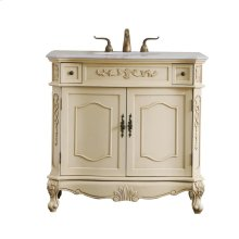 This elegant tradition beauty in a marble-topped vanity will gracefully adorn any home or office bathroom! Featuring a white marble countertop, occasionally with light brown streaks that highlight the hand painted light tan cabinet. The cabinet comes with 2 side drawers and 2 spacious doors, in ornately designed reed and floral carving, as well as […]