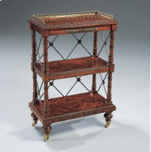 REGENCY FINISHED MAHOGANY GEOR GE IV BOOKCASE, BRASS MOUN TS AND CASTERS