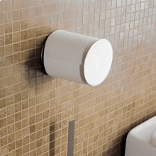 "Wall-mount toilet paper holder made of chrome plated brass. Diam: 4"", D: 4 3/4""."