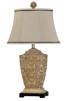 Traditional carved table lamp in tortola cream finish with natural linen shade and contrast trim
