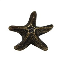 Solid brass starfish-shaped knob.
