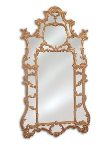 HAND-CARVED OVERSCALED BAROQUE MIRROR IN ANTIQUE GOLD WITH R ED UMBER HIGHLIGHTS