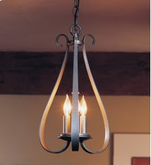 Chandelier: Sweeping Taper with three arms and three-candle cluster.