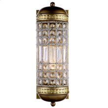 A profusion of multi-faceted crystals encircle this sparkling pendant. Metal rims have an antique brass finish.