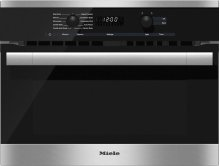 H 6100 BM AM 24 Inch Speed Oven With electronic clock/timer and combination modes for quick, perfect results.