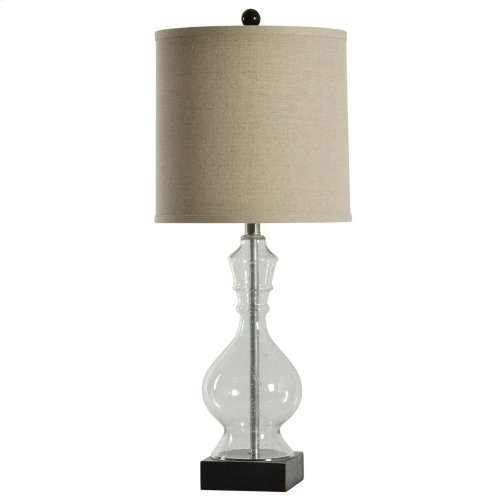 Clear seeded glass table lamp on black base with fabric drum shade