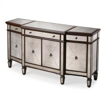 This magnificent buffet features elegant antique mirror inlays on its top; drawer fronts; sides and tapered feet. No detail is overlooked with a beveled edged top; beaded carving on its base and rich mahogany finished trim. Handcrafted from select hardwood solids and wood products with antique brass finished hardware; it boasts three separate storage areas - one behind each of the side doors and another behind the two center doors - each with one adjustable shelf.