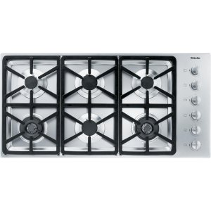 MieleKM 3484 LP Gas cooktop with 2 dual wok burners for particularly versatile cooking convenience.