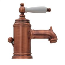 Fountainhaus single-hole, single-lever lavatory faucet with porcelain handle and pop-up waste.