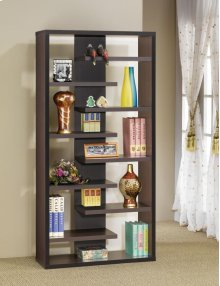 - Staggered eight shelf bookcase finished in cappuccino- Constructed with MDF, particle board, and engineered veneer- Also available in elm (#801349)