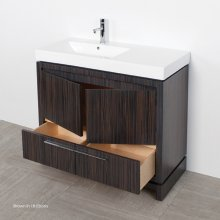 Free standing under counter vanity with finger pulls across top doors and polished chrome pulls across bottom drawers. Bathroom Sink 5457 sold separately