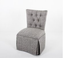 Button tufted skirted chair