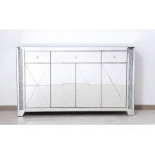 """With 4 doors in bold criss-cross symmetry, measuring W60""""xD14""""xH36, this modern credenza can decorate any dining room or narrow hallway and still yield plenty of storage space. With the gleaming beveled mirror surfaces and crushed diamond-like silver crystal inlay border, it opens up the visual space in the room while imbuing it with glamour. The […]"""