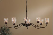 Chandelier: Oval with eight arms and water glass with frictional swivel for alignment.