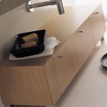 Free-standing bench with three drawers, polished chrome pulls and polished stainless steel legs included.