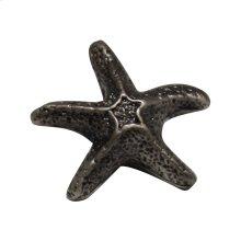 Solid brass starfish-shaped knob.