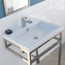 Floor-standing stainless steel console stand with a towel bar. It must be attached to wall.