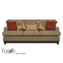 Sofa in Hanson Cypress with 5 decorative pillows and nailhead trim.